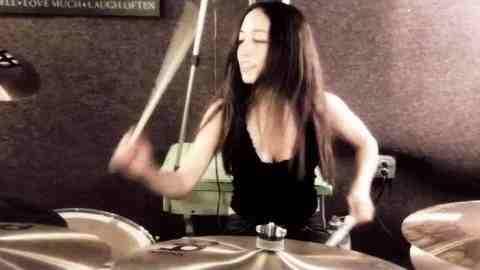 Senri Kawaguchi playing drums