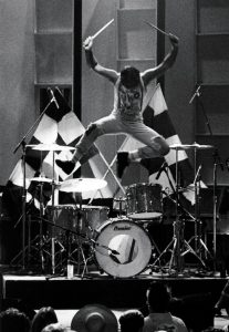 Clem Burke (of Blondie) jumping over his kit after a performance with his band Chequered Past at the Hollywood Palace in 1984
